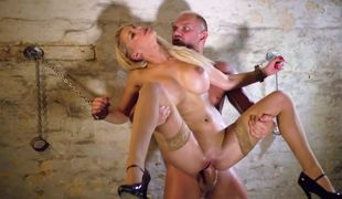 Blonde with big mambos is sitting down on a big erection