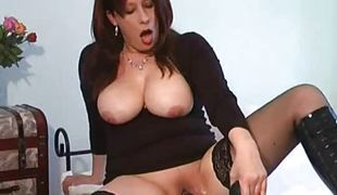 Mature bitch fucking a gigantic darksome vibrator