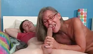 Milf gobbles down this stiff cock