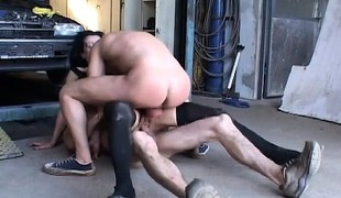 Two lewd mechanics drilling a sexy skinny milf's constricted holes at one time