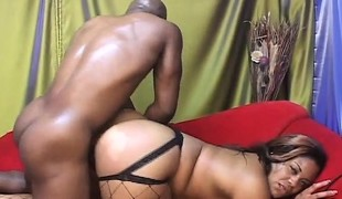 Curvaceous ebony sweetheart in fishnets takes a huge darksome ramrod for a ride