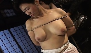 Mature floozy receives roped up and hung in a bdsm session