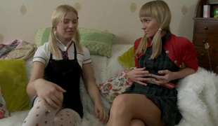 Alluring pair of steamy lesbians enjoy banging each other using a fake penis