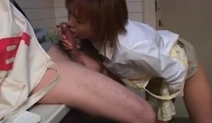 Cute housewife in an apron sucks cum from his weenie