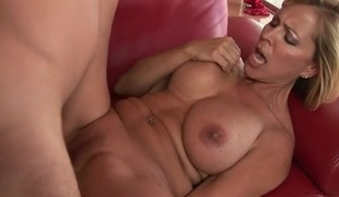 Hot milf on her back with a dick in her twat
