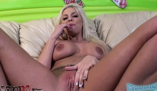 Stacked beauty Britney Amber toys her wet peach and bonks a long pole