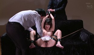 Slavery serf yelling when worked on with toy in BDSM