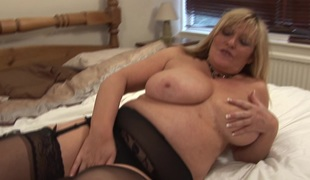 Chubby MILF with big tits Alisha loves fingering her soaked fur pie