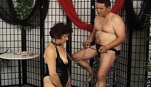 Granny decked out in her leathers must do what her dom tells her