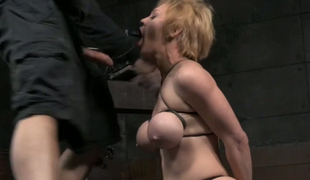 Short haired blonde with massive juggs gets face screwed in the dungeon