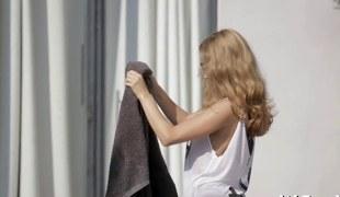 Beautiful curly dark brown masturbating by the swimming pool